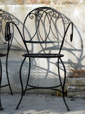 Garden chairs. Steel garden chairs in a row Stock Photos