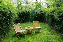 Garden chairs on the backyard. Chairs on backyard tropical garden Royalty Free Stock Photography