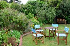 Garden chairs in garden Stock Image
