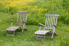 Garden chairs in the meadow Stock Photo
