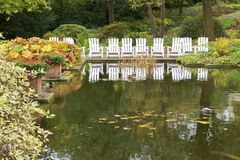 Garden chairs at the pond Stock Image