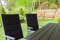 Garden chairs and table. Outdoor chairs and table in the garden Royalty Free Stock Photos