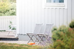 Garden chairs and white house Royalty Free Stock Image