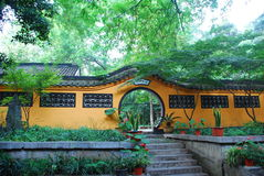 Garden in the Chinese style. Door and yellow wall Royalty Free Stock Photo