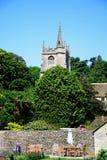 Garden with church to the rear, Castle Combe. Stock Photos