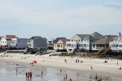 Garden city beach houses. View of beach houses with people on beach Stock Photography