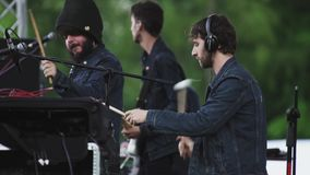 Garden city movement band musicians playing music on scene of open air festival stock footage
