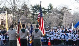 Boy Scouts holding flags for the Pledge of Allegiance royalty free stock photo
