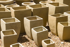Garden clay plant pots. Clay pots for garden plants in a nursery in earth colors Stock Images