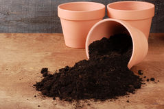 Garden Clay pot with spilled dirt Stock Photo