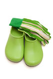 Garden clogs and gloves Royalty Free Stock Photos