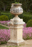 Garden with column, purple flowers and forest. Vertical Stock Photos