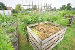 Garden Compost Bin. Compost bin in a vegetable garden Royalty Free Stock Image