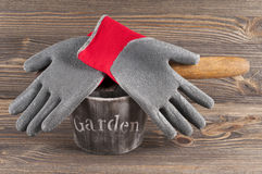 Garden concept still life with  gloves and gardener's trowel. Stock Photo
