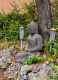 Garden corner whit Buddha statue and lamps Royalty Free Stock Photos