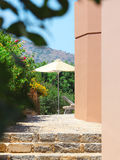 Garden Courtyard with beautiful flowers. Crete Royalty Free Stock Photos