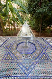 Garden courtyard with fountain and mosaic tiles in Moroccan palace royalty free stock images