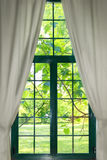 Garden through the curtains Royalty Free Stock Photo
