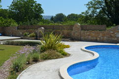 Garden with curved pool. Curved garden with path and blue pool Royalty Free Stock Photos