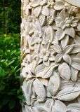 Garden deco exotic bali style. A photograph showing the details of a stone sculpture for gardens and home outdoor décor, with frangipani plumeria flowers carved Stock Photography