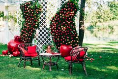 Garden decor. Decorated garden green wall and apples and grenades Stock Image