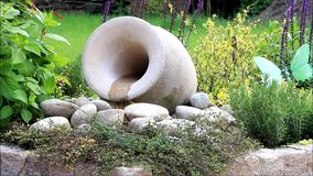 Garden decoration, amphora with flowing water stock footage