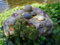 Garden decoration made of stone in a garden Royalty Free Stock Photo