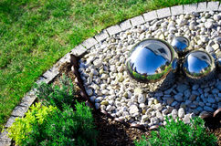Garden decoration with silver mirror spheres Stock Photography