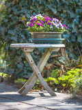 Garden Decoration Table with Bouquet Stock Image