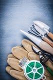 Garden dibber fork spade secateurs wire glove Royalty Free Stock Image