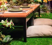 Garden Dinner. A japanese style dinner table setting in the middle of a garden Stock Image