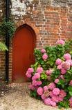Garden doorway. Small garden doorway tucked away in a corner Stock Photography