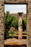 Garden Doorway In Pompeii, Italy. Doorway, column and garden in ruins of Pompeii, Italy Stock Photos