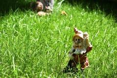 Garden Dwarf. Decoration on fresh green grass Stock Photo