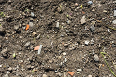 Garden earth with small ton pieces. Close up Royalty Free Stock Photo
