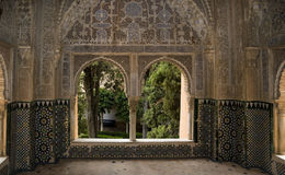 Garden of Eden 2. View through detail ceramic tiled archway to interior garden, Alhambra, Granada Spain Royalty Free Stock Photos
