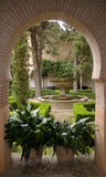 Garden of Eden. View through archway to interior garden, Alhambra, Granada Spain Royalty Free Stock Images