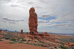 Garden of Eden Arches National Park. Lone sandstone formation stands vigil over desert terrain stock photos