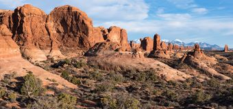 Garden of Eden Panorama with Monoliths and Arches at Arches National Park. Panoramic view of Garden of Eden with the Snow Capped La Sal Mountain Range in the royalty free stock photo