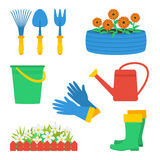 Garden elements set. Set of garden elements. Garden gloves, garden boots, watering can, fence and flowers, tire with flowers, garden tools (hand fork, hand Royalty Free Stock Photo