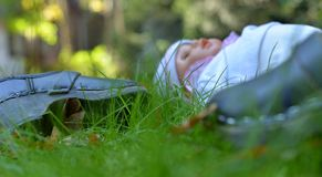 Clogs and doll left in the garden. royalty free stock photo