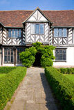 Garden and entrance of a tudor manor, UK Stock Photos