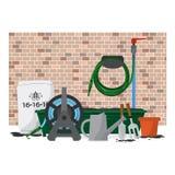 Garden Equipment In Front Of Brick Wall. Stock Photo