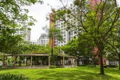 Garden Estate. A new colorful neighborhood estate behind a domestic garden in Singapore Stock Photos