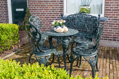 Garden exterior with table, chairs and wooden shoes in Netherlands Stock Photos