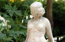 Garden Fairy. A Garden Fairy statue in a garden stock images