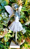 Garden fairy photographed with white flowers