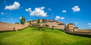 Garden of famous Basilica of St. Francis of Assisi, Umbria, Italy. Beautiful panoramic view of peaceful gardens of famous Basilica of St. Francis of Assisi ( Royalty Free Stock Photos