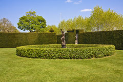 Garden feature. An impressive garden feature with bronze statue and water fountain found in an english country garden. Lytes Cary Manor, Tyntesfield Stock Photo