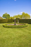 Garden feature. An impressive garden feature with bronze statue and water fountain found in an english country garden. Lytes Cary Manor, Tyntesfield Stock Photos